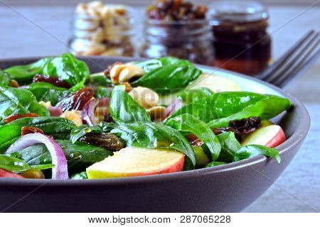 Apple Salad With Basil, Raisins And Blue Onions. Salad With Apple And Peanuts. Healthy Vegan Salad.