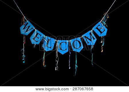 Welcome Party Banner. Blue Bunting Letters Spelling The Word Welcome With Celebration Streamers Isol