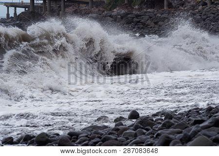 Huge Wave Breaking On The Coastline Of Portuguese Island Of Madeira