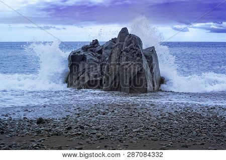 Waves Splashing At The Rock At Sunset. Praia Formosa Beach In Funchal, Portugal