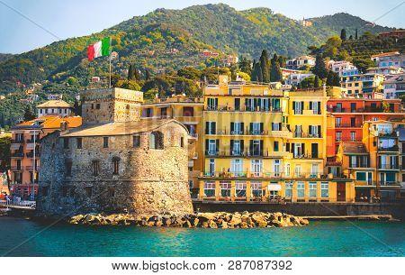 retro italian castle seaside vintage travel background Castello di Rapallo italian riviera - Italy . poster