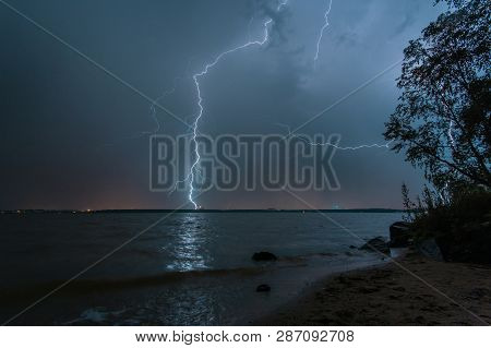 Summer Thunderstorm Over The Volga. The Shine Of Lightning Illuminates The Night Sky Over Kineshma.
