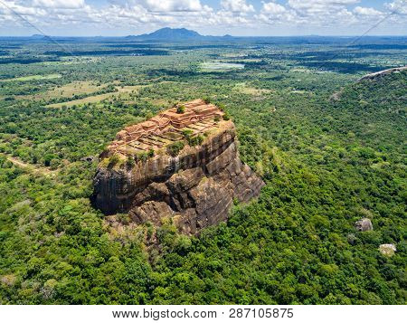 Aerial View From Above Of Sigiriya Or The Lion Rock, An Ancient Fortress And A Palace With Gardens,