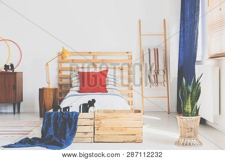 Trendy Retro Design In Bedroom With Wooden Furniture And White Wall, Real Photo