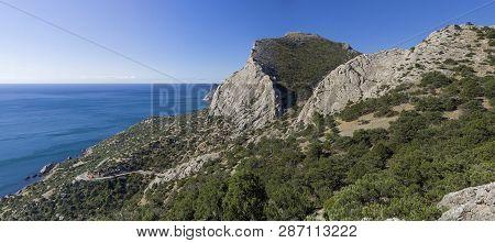Mountains On The Black Sea Coast Of Crimea. The Coast Between Sudak And Novyy Svet. Sunny Day At The