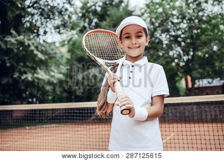 I Choose Healthy Way With Tennis! Portrait Of Pretty Sporty Child With Tennis Racquet. Cute Little G