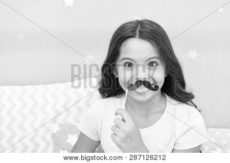 Slumber Party Photo Booth Props. Kid Girl Cheerful Posing With Black Mustache Party Attribute. Prepa