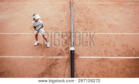Child Playing Tennis On Outdoor Clay Court. Top View Of Little Tennis Player On Open Tennis Court. F