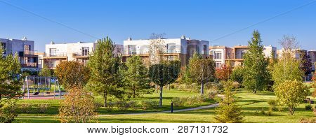 Park With Gardens In Modern Town. Scenic Panorama Of Natural Public Place. Beautiful Green Park On S