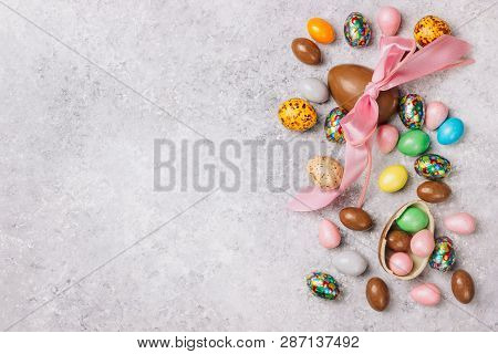 Sweet Sugary Easter Candy eggs on light gray backround. Top view poster