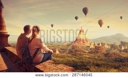 Happy Tourists, Friends, Enjoy Watching The Flight Of Balloons Over The Old Bagan In Myanmar. Young
