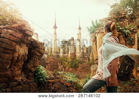 Woman Tourist Enjoying View A Looking At Buddhist Stupas In Famous Ancient Indein. Burma, Asia.  Tra