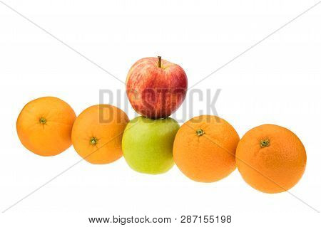Compare Apples With Oranges. Conceptual Shot Around Differentiation And Specialities.
