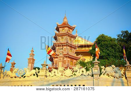 Buddhist Temple And Pagoda Buu Son Lit By Sunset.  Vietnam.