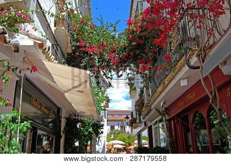 Marbella, Spain - May 26, 2008 - Narrow Shopping Alleyway Leading To Orange Square In The Old Town W