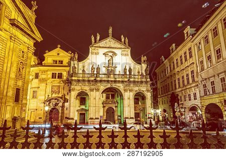 Saint Salvator church in Prague, Czech republic. Architectural scene. Travel destination. Night scene. Yellow photo filter. poster