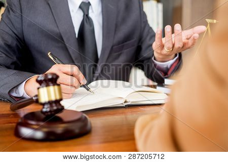Lawyer In Office. Counseling And Giving Advice About Legal Legislation In Courtroom To Help Customer