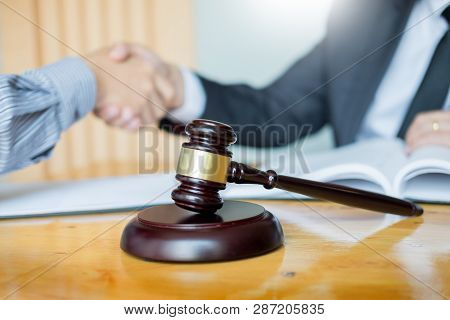 Law And Legal Concept, Consultation Between Attorneys And Clients Customer Shaking Hands Discussing