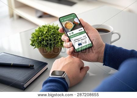 Man Hands Watch Holding With App Delivery Food On Screen Above Table In Office