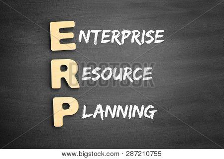 Wooden Alphabets Building The Word Erp - Enterprise Resource Planning Acronym On Blackboard