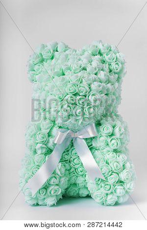 Green Teddy Bear Toy Of Foamirane Roses. White Stripe On Teddy Neck. Stock Photo Isolated On White B