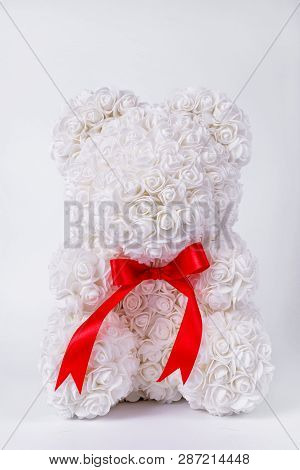 White Teddy Bear Toy Of Foamirane Roses. Red Stripe On Teddy Neck. Stock Photo Isolated On White Bac