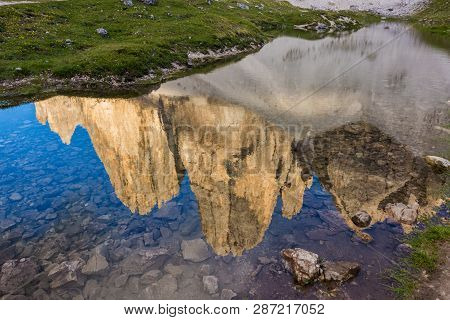 Reflection Of Tre Cime Peaks At The Nearby Lake, South Tyrol, Italy
