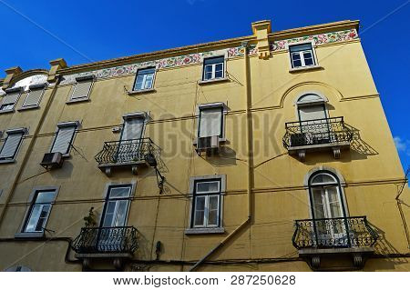 Yellow House On The Street Travessa Do Carvalho In Lisbon, Portugal. November 01, 2018. Editorial Ph