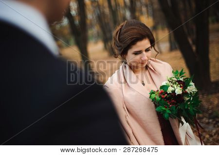 Couple Walks In The Park. Romantic Embrace Of Newlyweds.