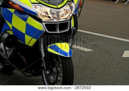 Front Headlight Of Speeding Police Motor Bike