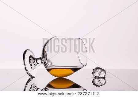 A Glass Of Brandy And Any With A Reflection On The Glass. The Composition Of The Alcoholic Beverage