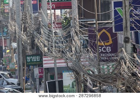 Messy And Dirty Cable Lines On Electricity Power Pole.