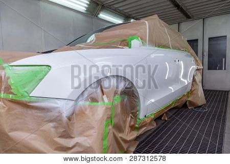 The Car Front View After The Accident In The Camera For Car Body Repair Is Partially Covered With Pa