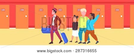 Mix Race Tourists Family With African American Bellboy Carrying Luggage To Guest Room Hospitality St