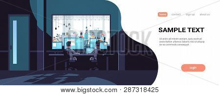 Two Men Looking At Monitors Sitting Behind Glass Window People Working In Co-working Open Space Offi