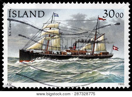 Luga, Russia - February 13, 2019: A Stamp Printed By Iceland Shows 1875-built Steamship Laura, Circa