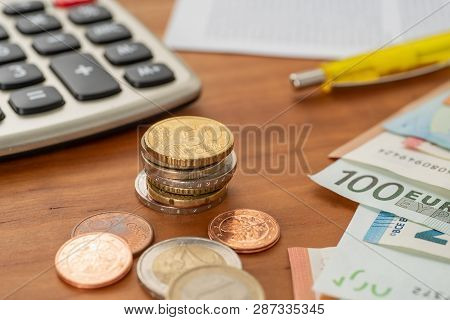 Money And A Calculator On A Desk