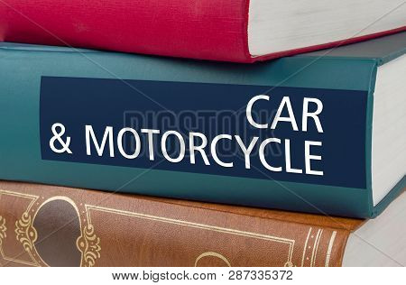 A Book With The Title Car And Motorcycle Written On The Spine