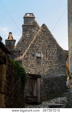 Typical French townscape with ancient housest and cobblestone street in the traditional town Beynac-et-Cazenac, France poster