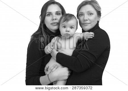 Grandmother, Daughter And Granddaughter On White Portrait, Happy Family Concept. Black And White