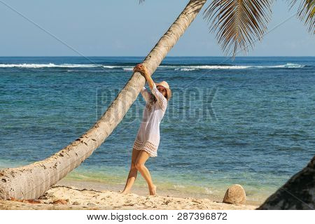 Traveler Girl Enjoying On Tropical Beach. Young Girl Traveler Relaxing In Vacation. Traveler Relaxin