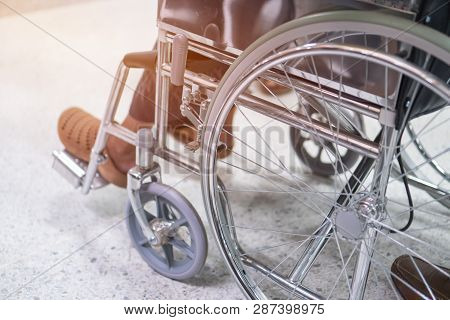 Disabled Older Patient Sitting Wheelchair Waiting Services Therapy  From Doctor In Hospital Clinic.