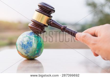 Earth Destruction And Destroy Environmental By Hand Human Concept. Judge Gavel / World Model Should