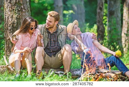 Company Friends Relaxing And Having Snack Picnic Nature Background. Company Hikers Relaxing At Picni