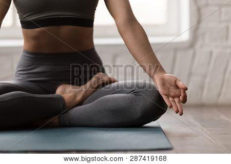 Young Woman Practicing Yoga, Sitting In Padmasana Pose, Lotus Exercise