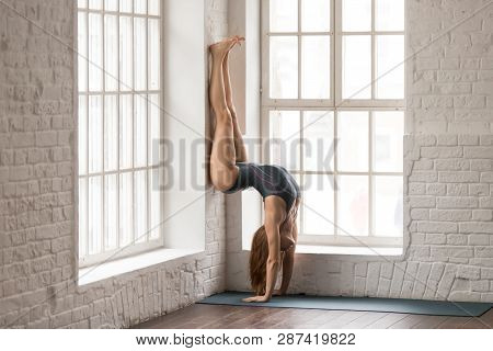 Woman Practicing Yoga, Downward Facing Tree Pose, Adho Mukha Vrksasana