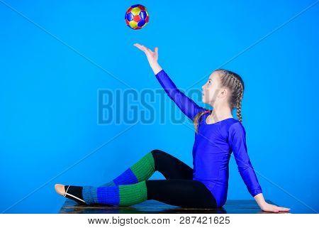 Practicing gymnastics hard before performance. Flexible healthy body. Rhythmic gymnastics sport combines elements ballet dance. Girl little gymnast sports leotard. Physical education and gymnastics poster