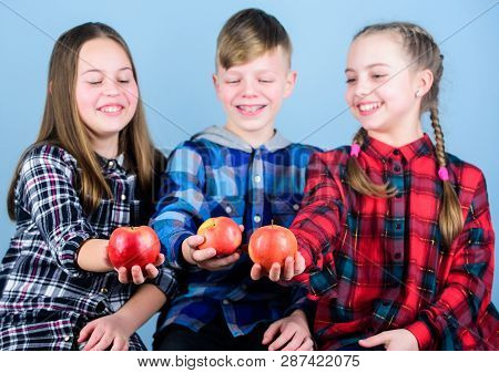 Promoting Healthy Nutrition. Group Teenagers Cheerful Kids Hold Apples. Boy And Girls Friends Eat Ap