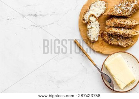Slice Of Bread With Butter On White Background Top View Copy Space