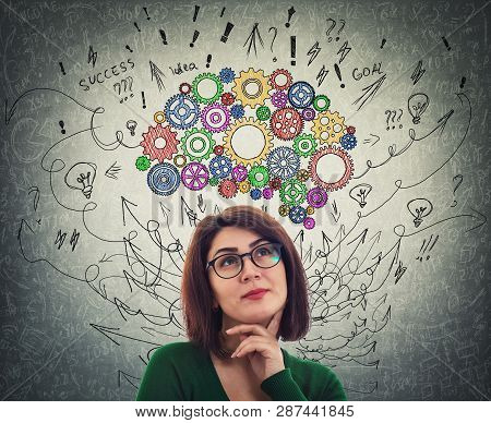 Portrait Of A Young Woman With Colorful Cogwheel Brain Above Head. Happy Emotion, Positive Thinking